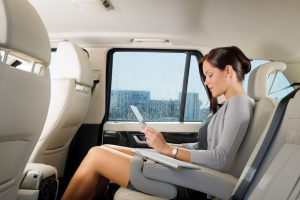 a businesswoman in town cars