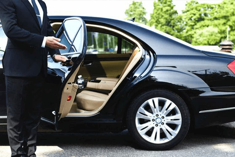 the chauffeur opened the door of the Mercedes s class